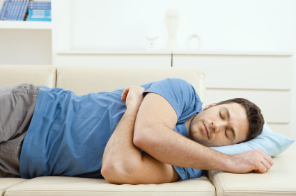 """Young handsome man sleeping on couch at home, side view. Click here for more """"People at Home"""" images:  [url=my_lightbox_contents.php?lightboxID=1507925][img]http://www.nitorphoto.com/istocklightbox/peopleathome.jpg[/img][/url]  [url=my_lightbox_contents.php?lightboxID=5638799][img]http://www.nitorphoto.com/istocklightbox/szendi.jpg[/img][/url]"""